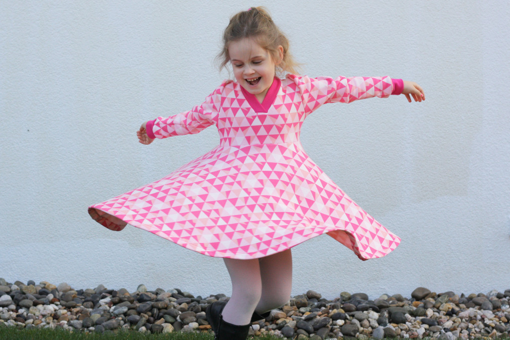 pink co-z dress swirrling girl